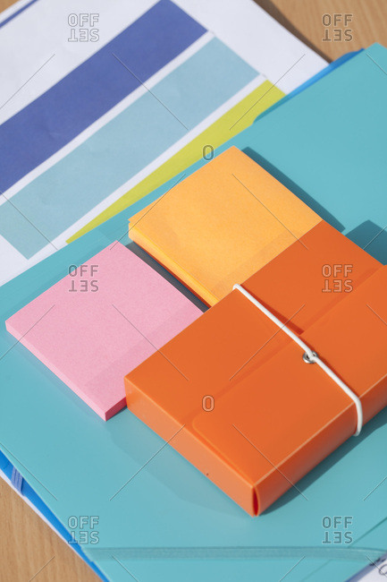 Notepads and paperwork in office
