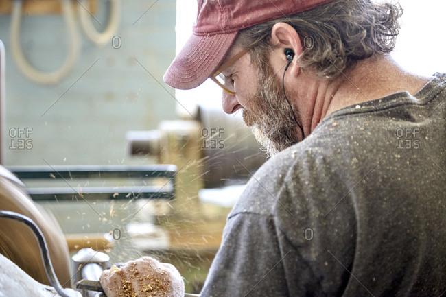 Rear view of craftsperson working in workshop