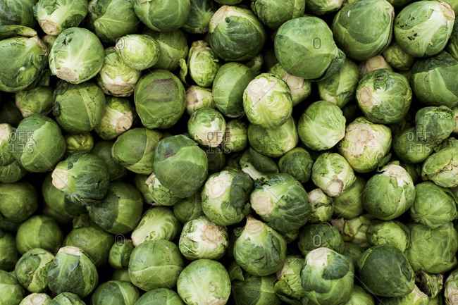 Many Brussels sprouts on display at farmers' market