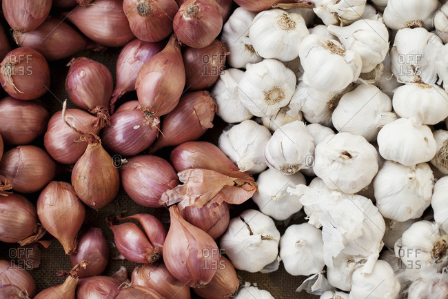Shallots and garlic on display at farmers' market