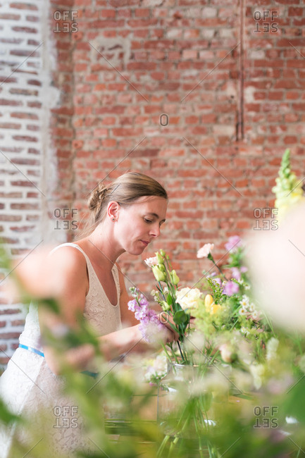 A woman arranges flowers