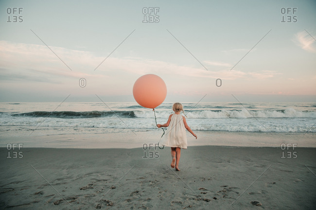 Girl at beach with a balloon
