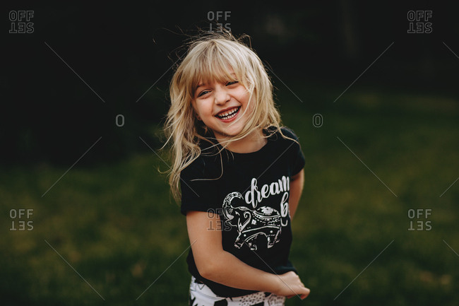 Smiling girl in t-shirt in yard
