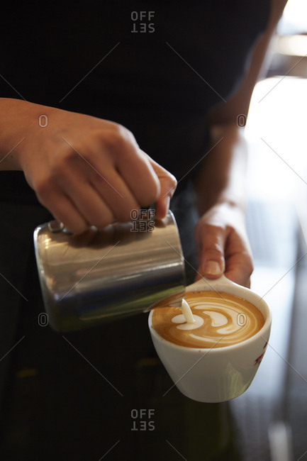 Person making a latte drink