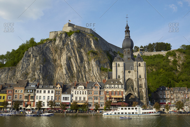 Dinant, Belgium - August 13, 2017: Boats and houses along the shore
