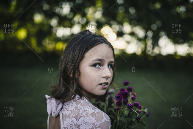 Girl in lace dress with flowers