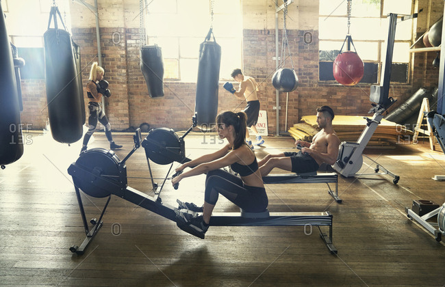 People exercising in boxing gymnasium