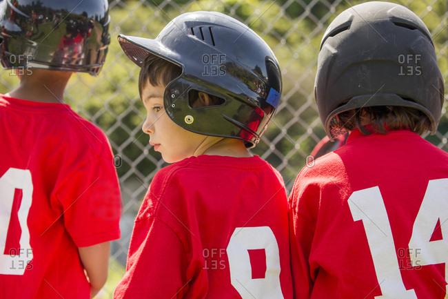 Mixed Race boy playing baseball