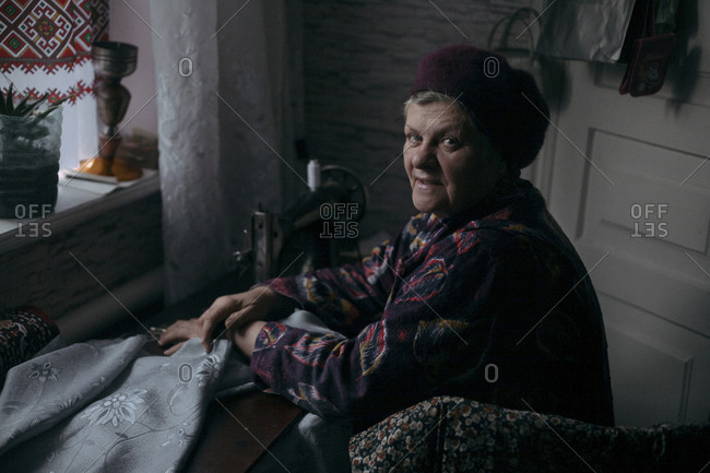 Older Caucasian woman using sewing machine