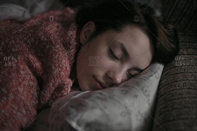 Caucasian woman sleeping on pillow