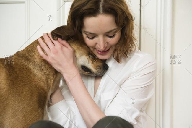 Caucasian woman hugging dog - Offset