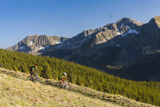 Caucasian couple mountain biking
