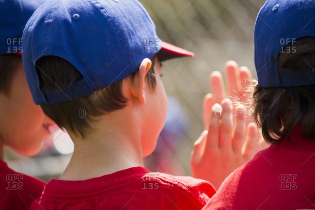Mixed Race boys playing baseball high-fiving