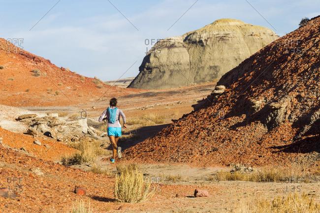 Native American woman running in desert