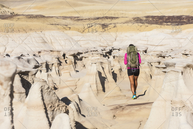 Native American woman hiking in desert