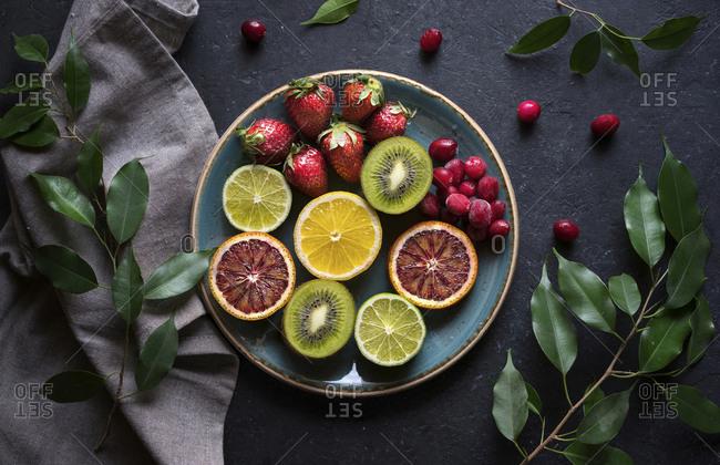 Plate of sliced fresh fruit