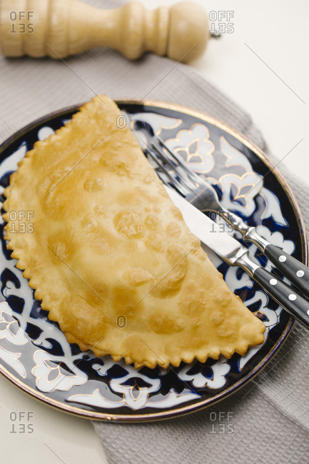 Pastry on plate with fork and knife