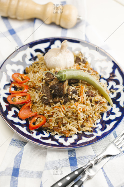 Pepper and onion on plate with beef and rice