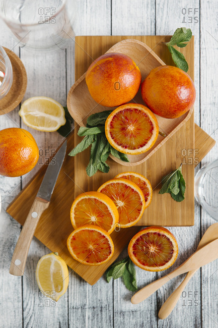 Sliced oranges on cutting board