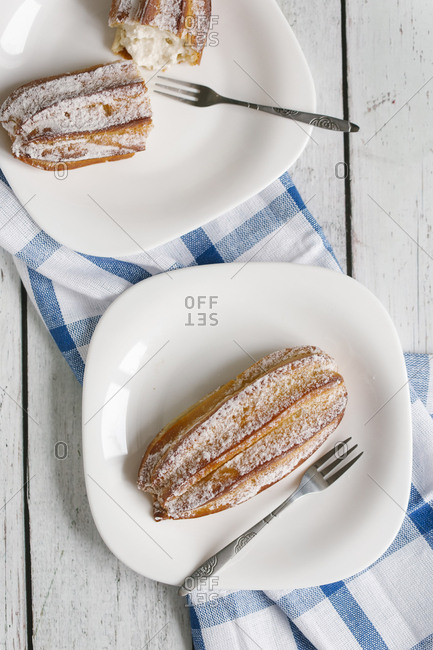 Pastry with powdered sugar on plate with fork