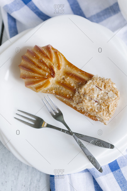 Pastry on plate with forks