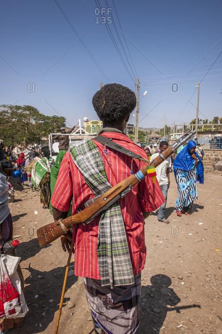 Bati, Welo, Ethiopia - November 29, 2010: Man with a rifle at the market of Bati
