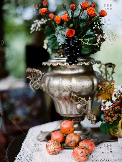 Flowers and fruit in a large urn
