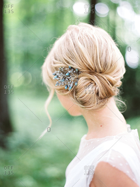 Bride with beads in her blonde hair looking away