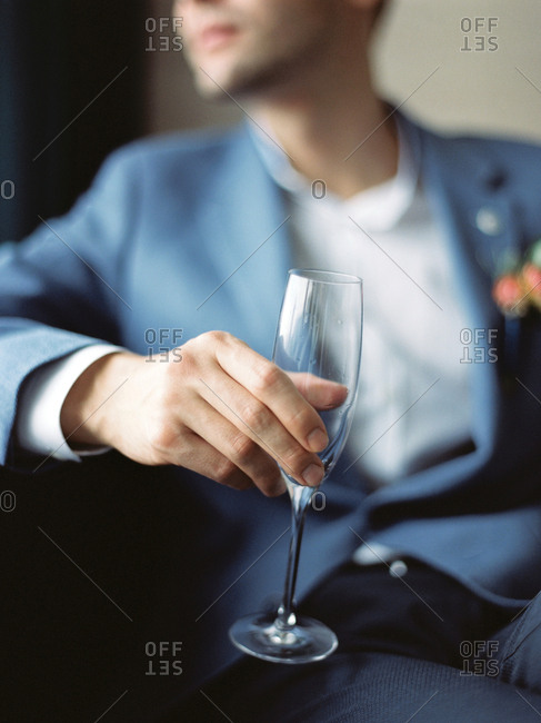 Man holding champagne flute