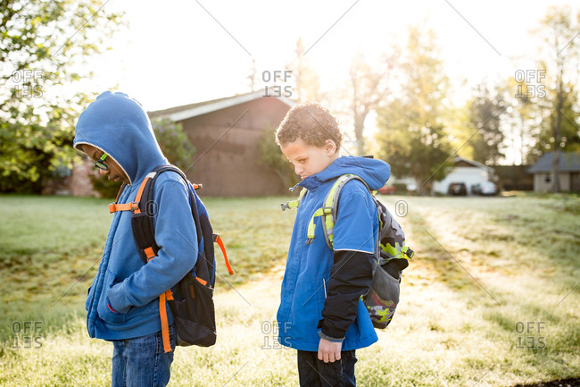 Two boys waiting at bus stop