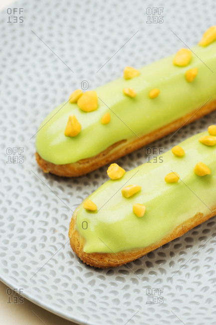 Green French eclairs with a topping