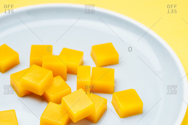 Orange marmalade candies on plate