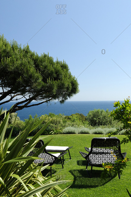Outdoor furniture in yard with a view of the sea