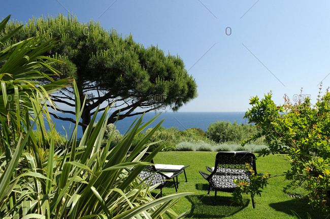 Outdoor furniture in yard with a view of the ocean