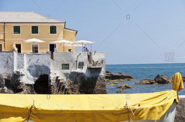 Genoa, Italy - June 16, 2011: Covered boat docked by the sea