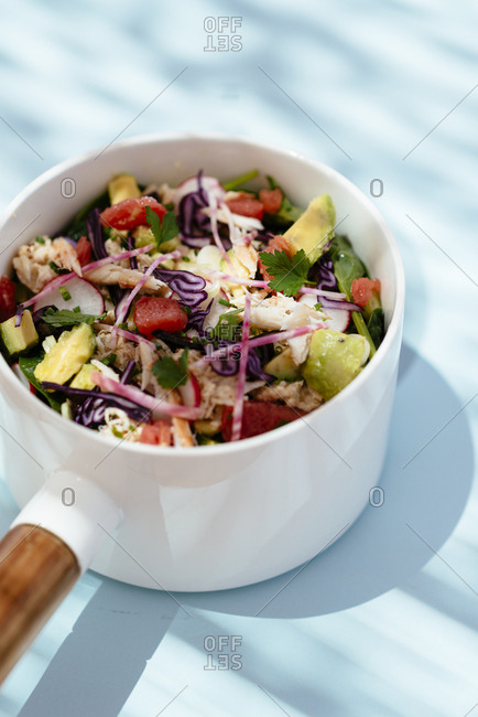 Seafood salad served in bowl with handle
