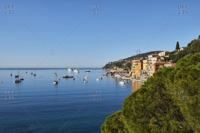 Scenic view of boats and town along the Mediterranean coastline in France