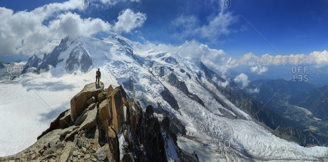 An alpinist contemplates the view of Mont Blanc after climbing the Aiguille du Midi, the French Alps
