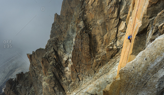 Alpinist climbing the Aiguille du Midi, French Alps