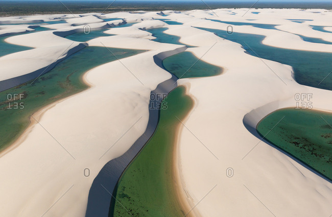 Aerial view of sand dunes and lagoons in Lencois Maranhenses National Park