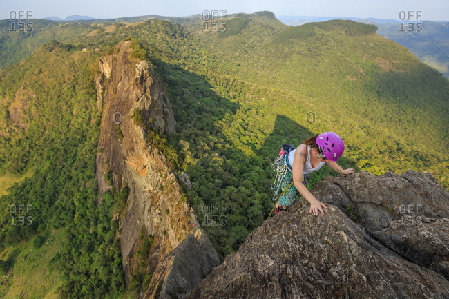 Woman climbing a mountain in Pedra do Bau