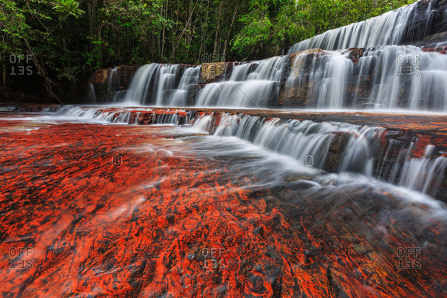 Waterfall with semi precious red rocks