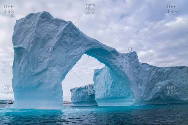 Iceberg arch in Antarctica