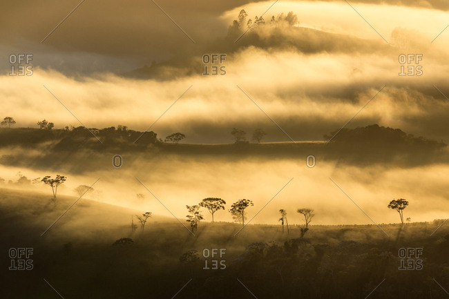 Dawn with fog over the mountains
