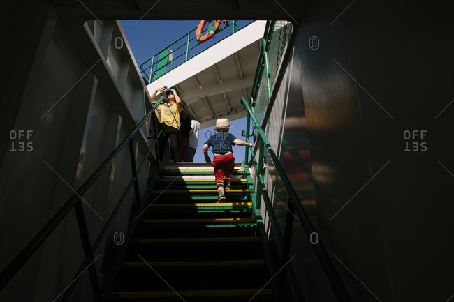 Boy going out of a ferry