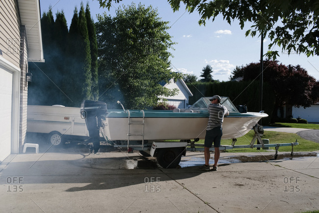 Man with a boat in driveway