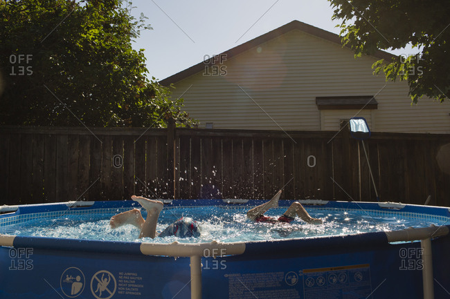 Boys playing in above ground pool