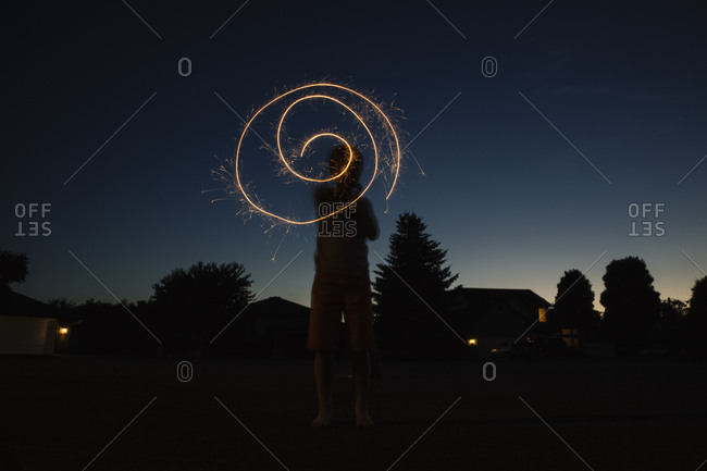 Boy making circles with sparklers
