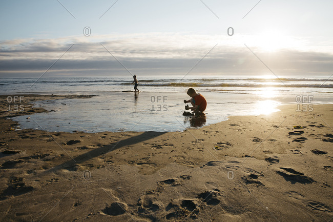 Boys on a beach in evening