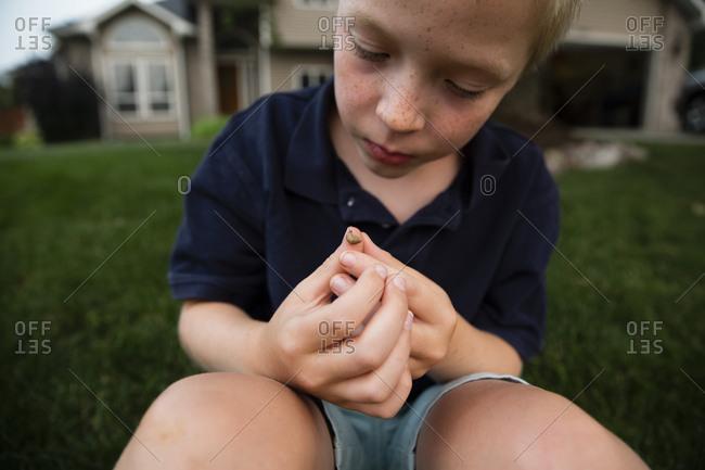 Boy looking at his hurt thumb